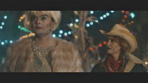 Hader in a wig with Wiig