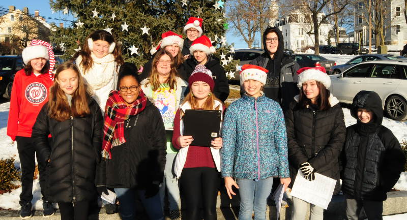 Middle school carolers bring seasonal cheer to downtown Ipswich