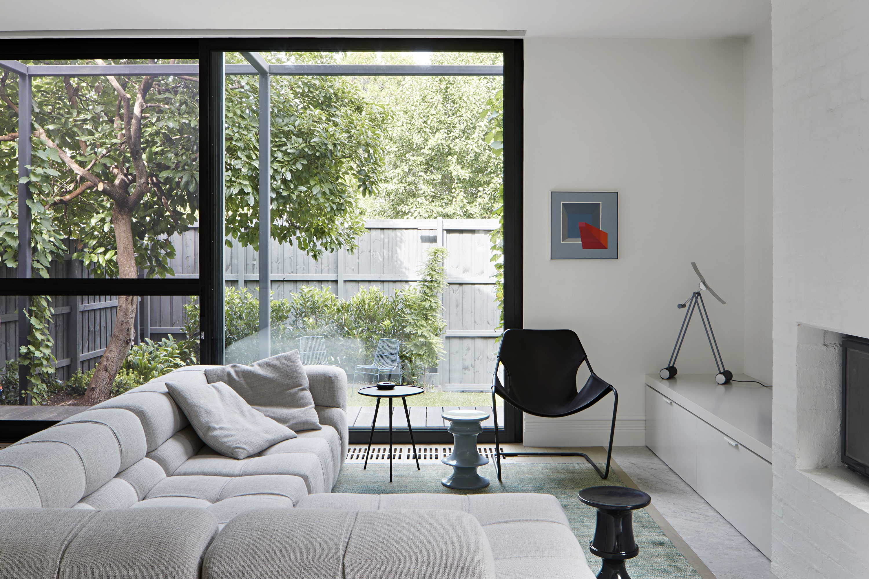 The Home Is Enlivened By Their Fascinating Art Collection, Which Is Offset By The Neutral Material Palette.