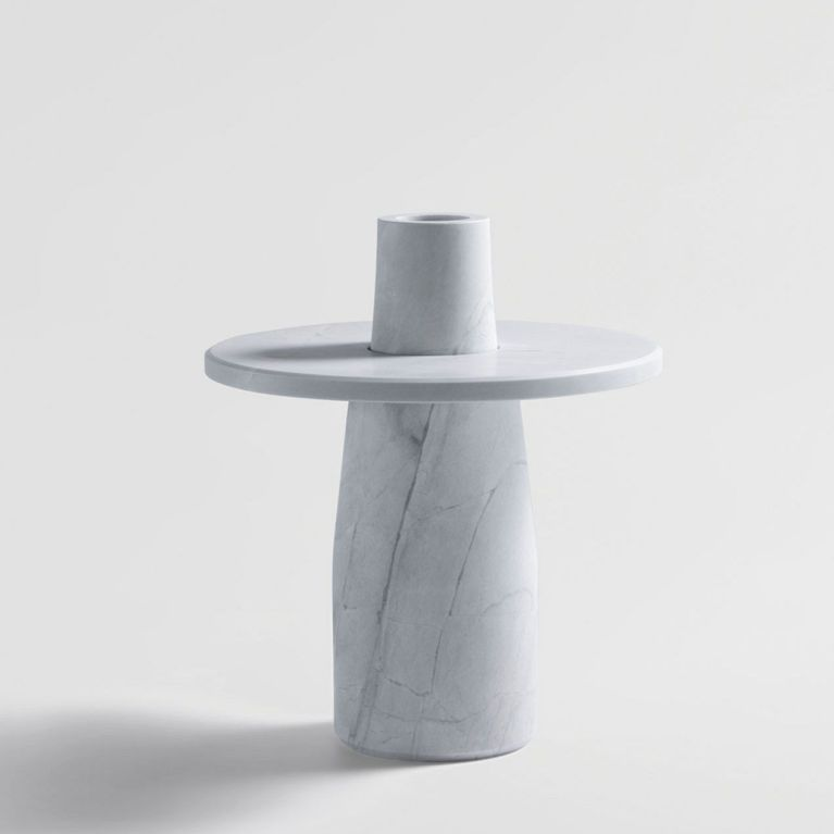 A Short Statured Vase Made From Solid Stone In Two Parts, The Semper Vase Is Designed To Highlight Fallen Leaves And Petals Through Capturing Them On Its