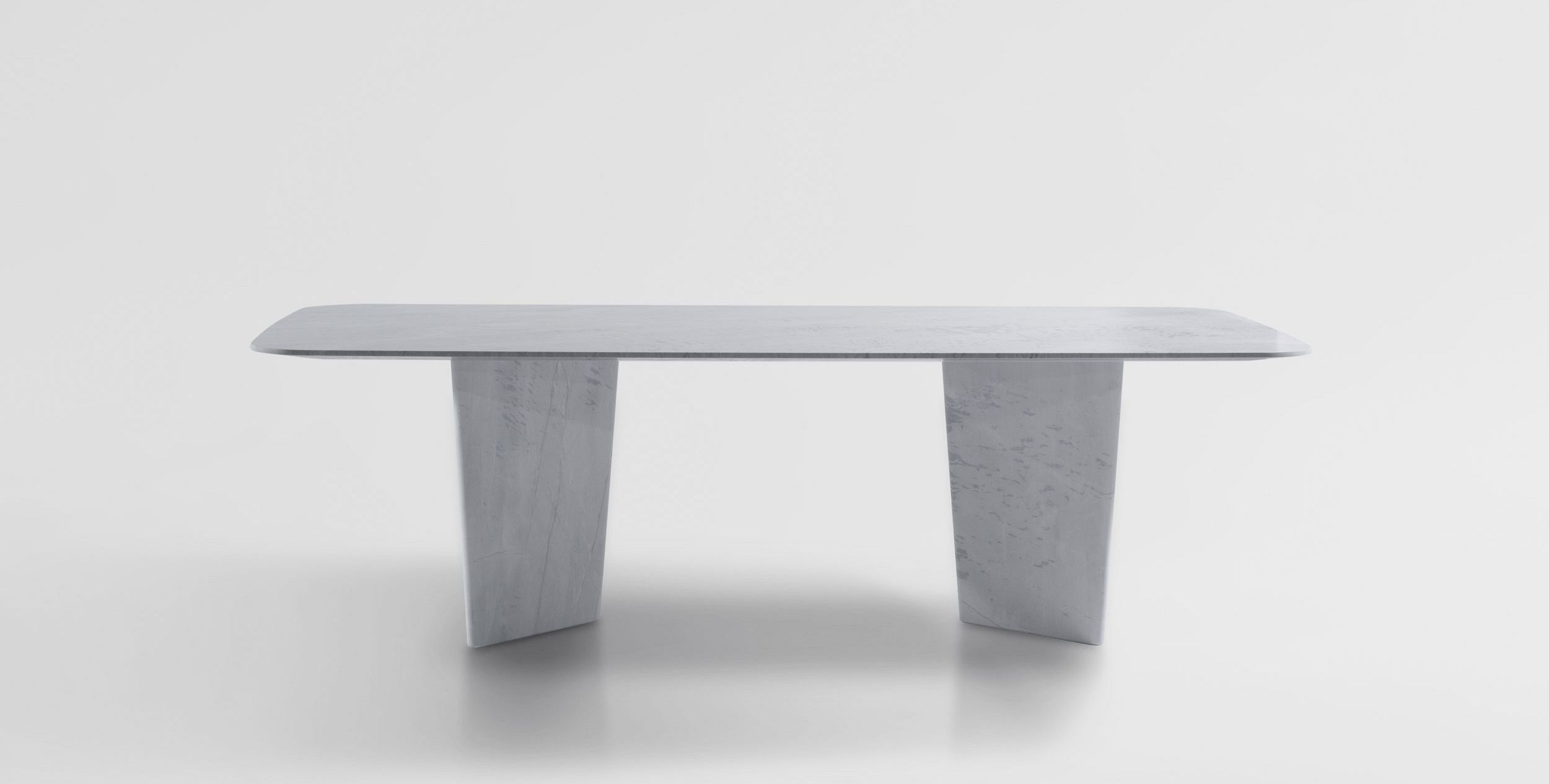 A Slender Rectangular Table Top Rests Upon Two Beautifully Angular Bases.