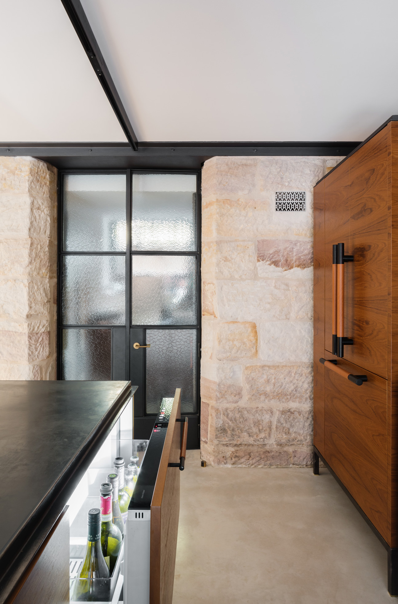 Slate Benchtops With Steel Angle Edges, Thin Steel Shelving And Elegant Teak Veneer Cabinetry Reference The Home's Overall In