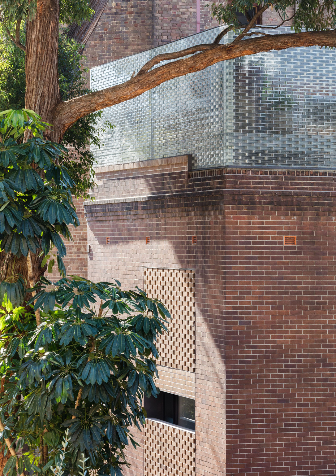 Extruding The Traditional Red Brick Exterior Upwards Into A Crown Of Glass Bricks That Are Softly Illuminated At Night, Semi Translucent
