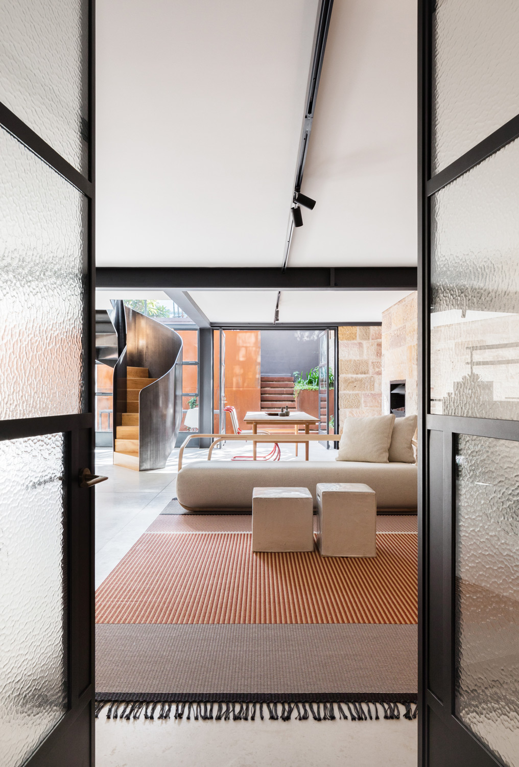 It Enables The Room To Be Read As A Singular Simple Space Allowing The Sandstone Perimeter Walls To Define The Overall Space