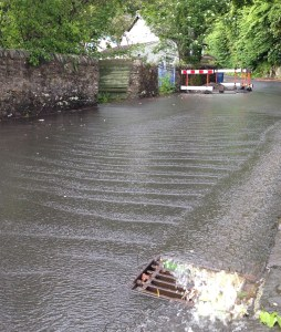 A river runs through it - the full with of School Road was covered in water.