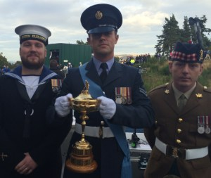Michael (on the left) is pictured with his colleagues from the RAF and Army, together with the Ryder Cup.