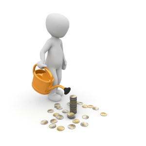 Image of a person tending to a stack of coins