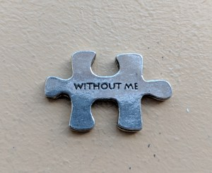 the other side of the puzzle piece says without me