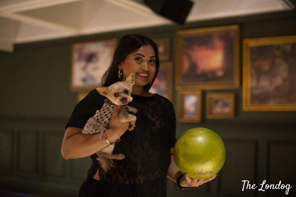 Woman and dog at bowling