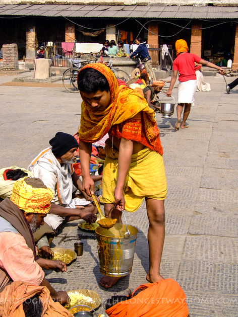 Sadhu's inside a temple compound being fed
