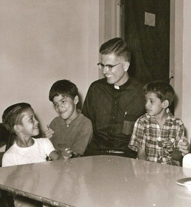 Fr Thomas with laughing with some kids