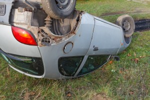 Traffic accident, car after rollover lie on the roof