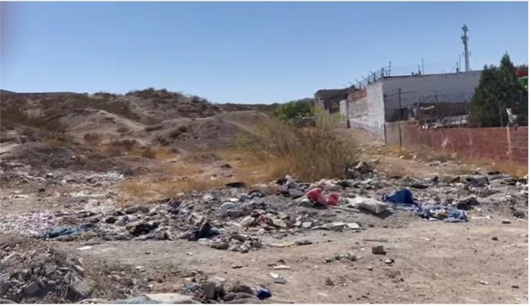 plot of land full of trash and debris