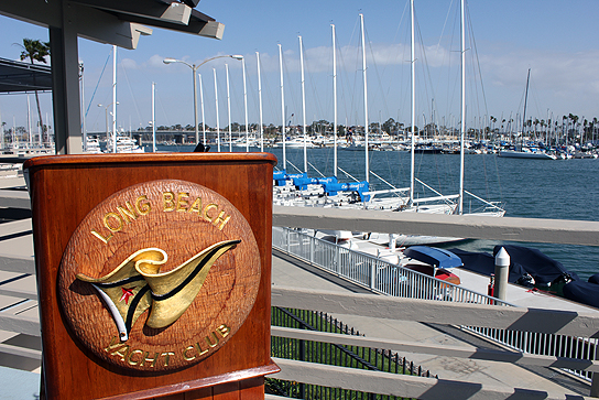 Yachts stand ready for racing at the dock of the Long Beach Yacht Club.