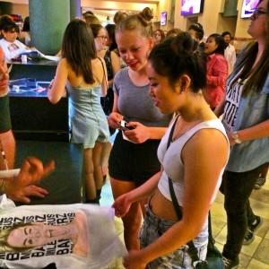 Miley fans shop for merch (photo by Nikki Kreuzer)