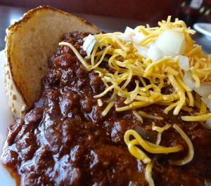 Cheddar cheese and chopped onions make the perfect topping for a chili size