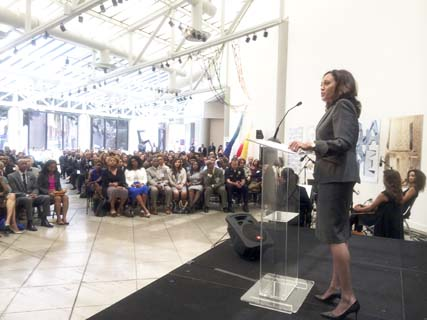 Attorney General Kamala Harris speaking to a full house
