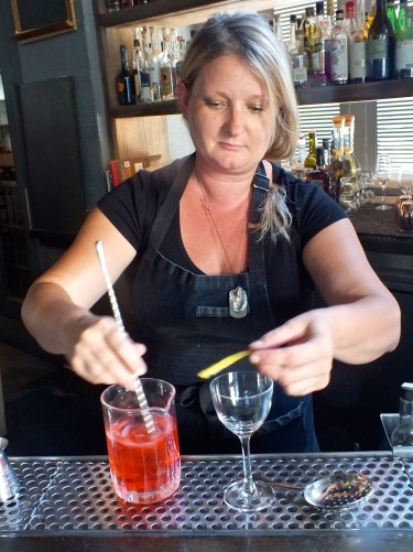 Gaby mixing a drink at the bar in Ink. Photo by Edward simon for The Los Angeles Beat.