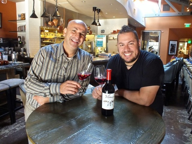 Ahmed Labatte and Chef Amar Santana sharing some Spanish wine. Photo by Ed Simon for The Los Angeles Beat.