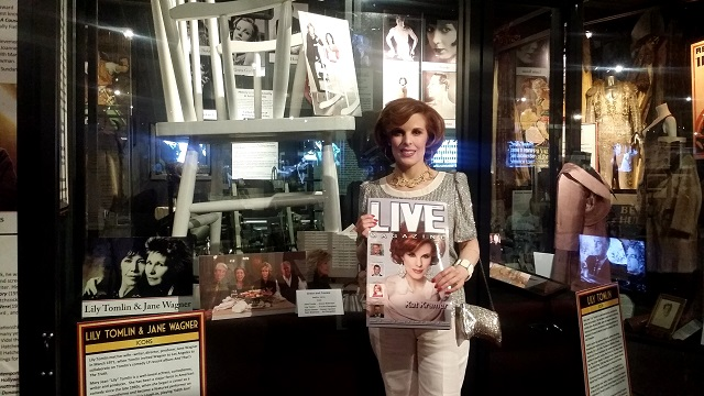 Kat Kramer in front of family friend Lily Tomlin Display, Photo by Jennifer K. Hugus for The Los Angeles Beat