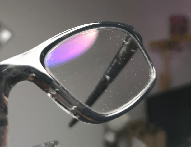 Dust on a Spectacle Frame with Anti Reflective Coating