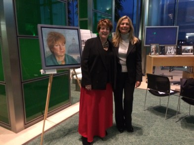 Former IWF UK chair Susan Young with the artist who painted her Christine Klein