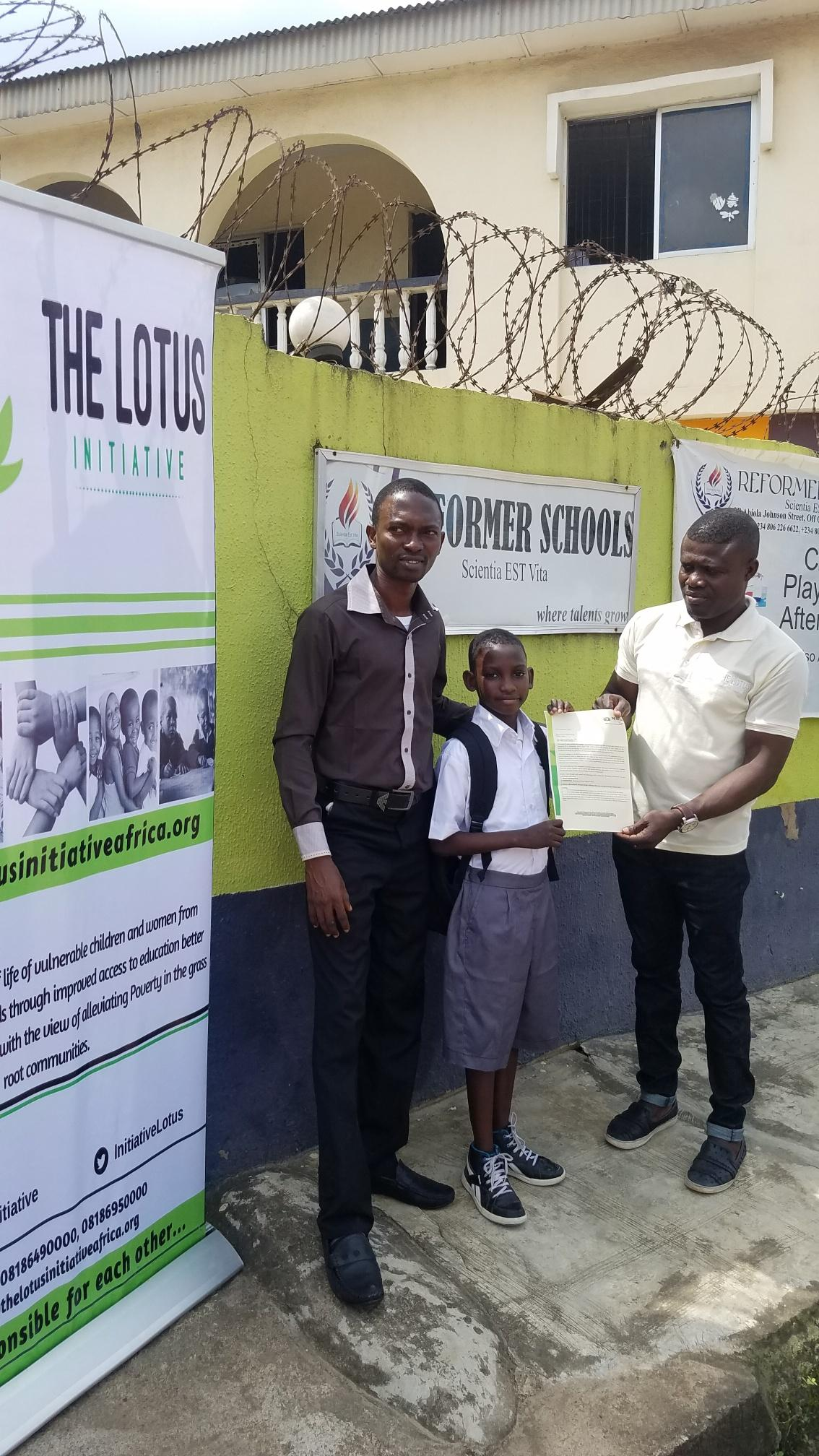 Lotus Initiative Program Manager presenting scholarship offer letter to Master Samuel Sham Adams with a staff of Reformer College.