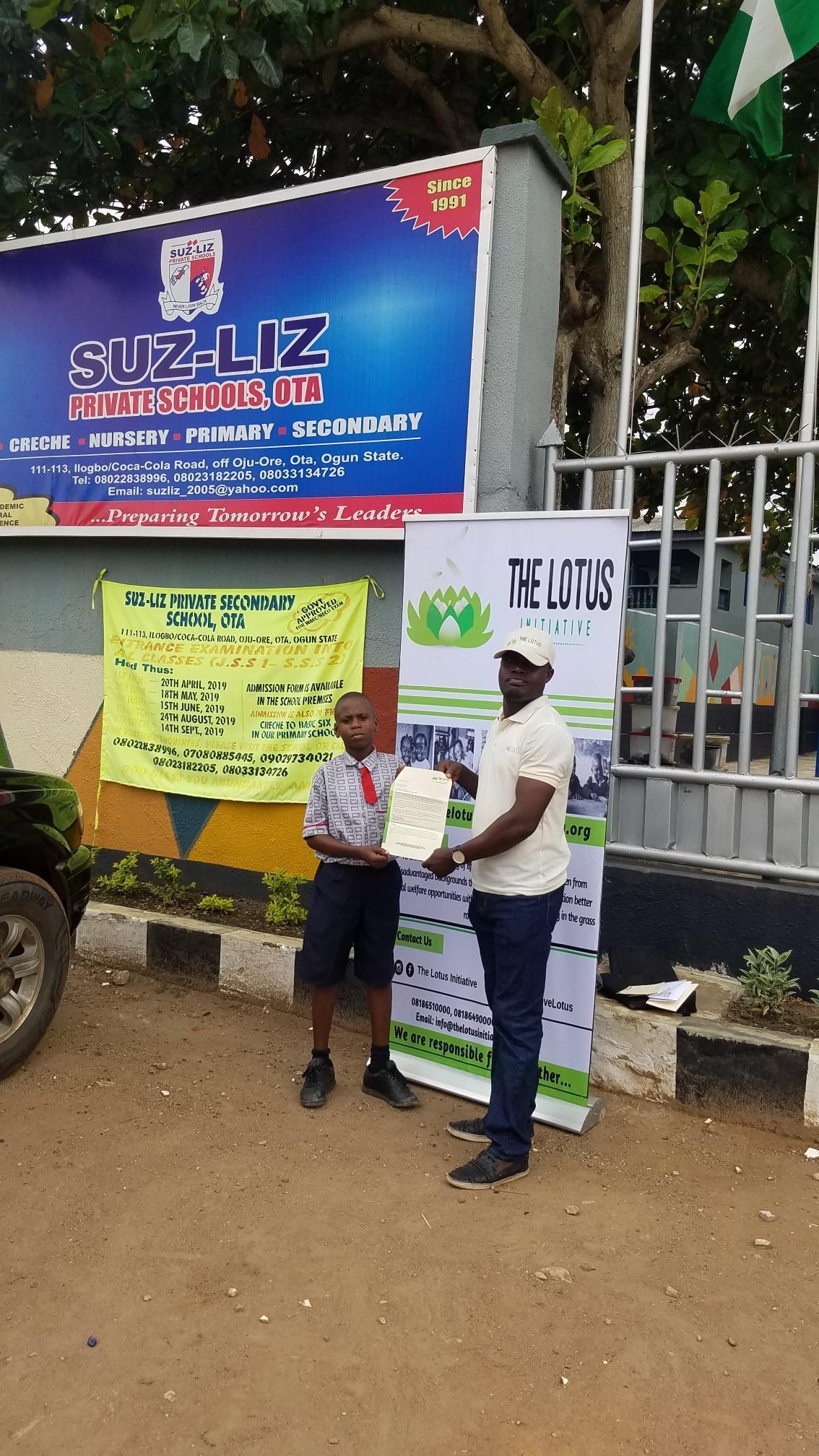 Presentation of Scholarship letter to Master Daniel Eyitayo.