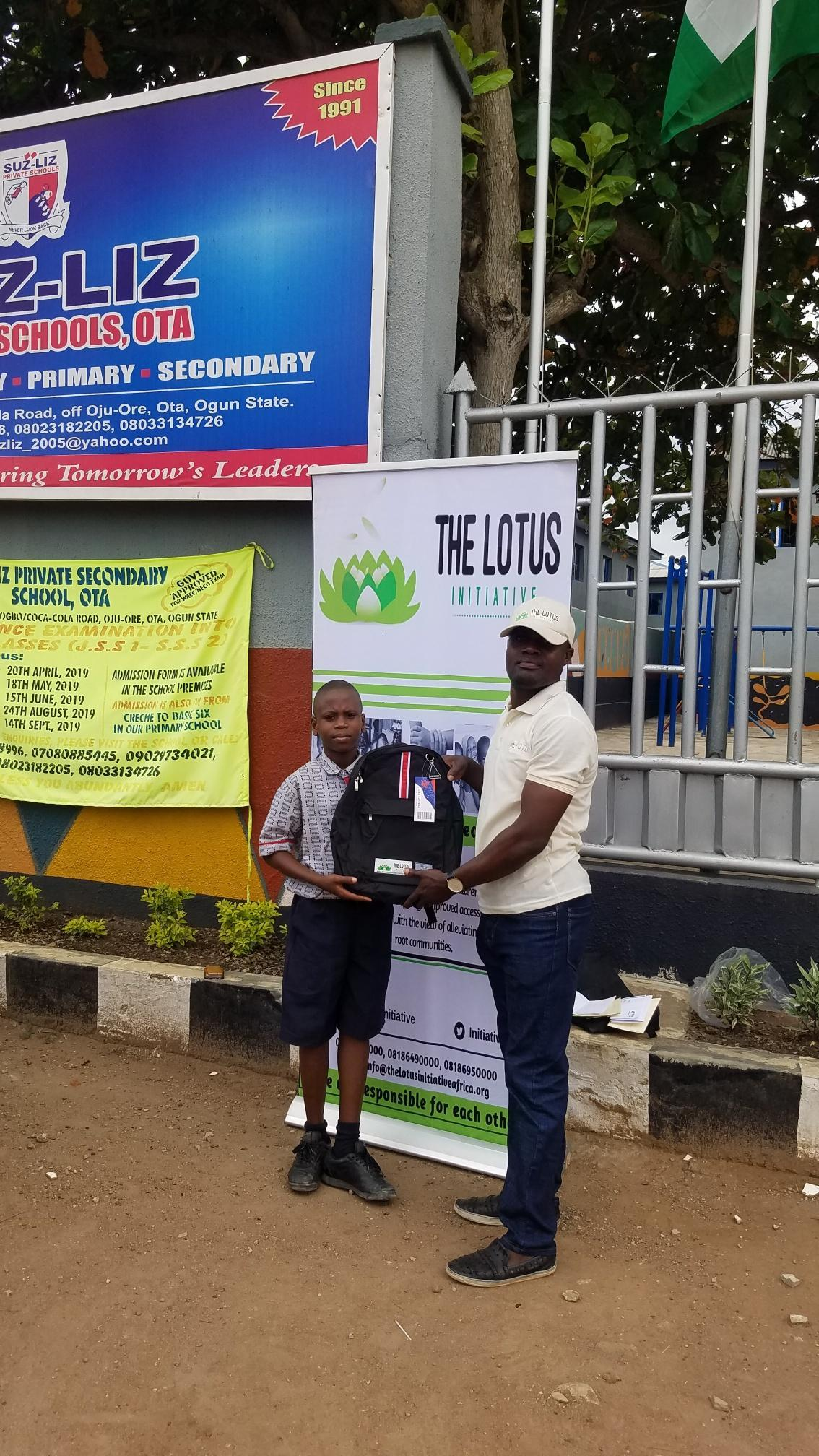 Lotus Initiative Program Manager with Lotus scholar Daniel Eyitayo of Suz-Liz Group of Schools, Otta.