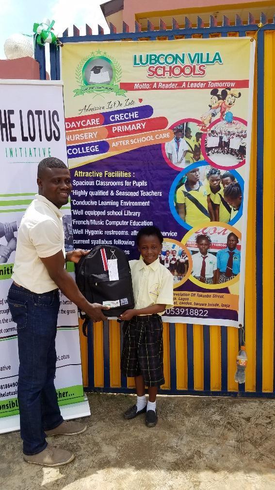 Presentation of scholarship letter to Imoleayo Alaka