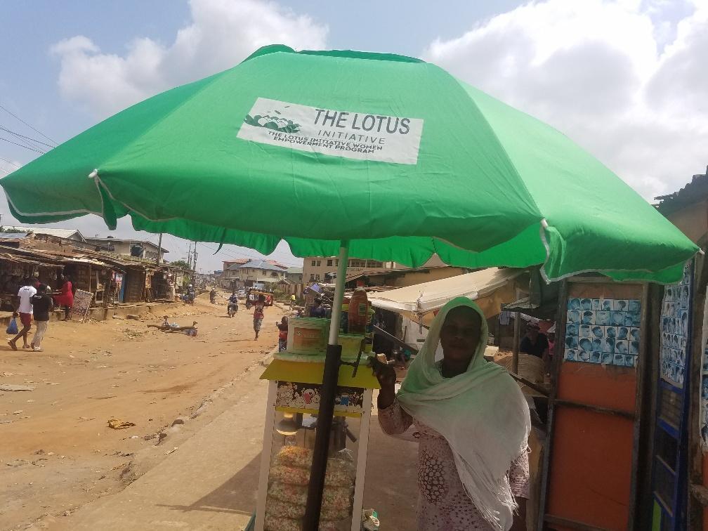 Presentation of Lotus Umbrella to a Popcorn Vendor Mrs. Bukky Banire