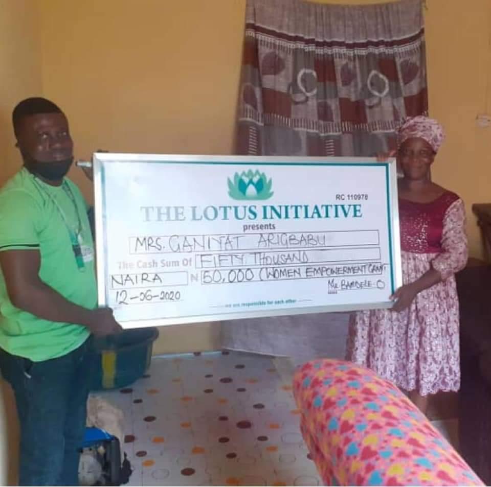 Presentation of 50k grant to Mrs. Ganiyat Arigbabuwo under Women Empowerment Grant of Lotus Initiative.