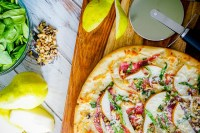 Spinach Pear Prosciutto Pizza with Honey and Walnuts is my favorite flatbread recipe so far! It's easy to make but will make quite the impression! | The Love Nerds