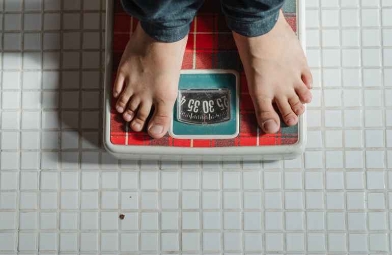 crop kid weighing on scale