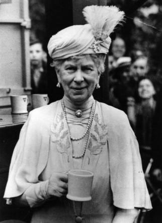5th August 1942: The dowager Queen Mary (1867 - 1953), enjoys a cup of tea during a visit to a YMCA in Cheltenham.