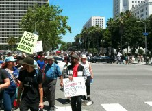 Protestors march down Spring Street in LA | Photo by Kelly Bessem