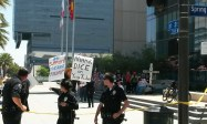 A small crowd of anti-science advocates sits in front of the LA Police Department Headquarters | Photo by Kelly Bessem