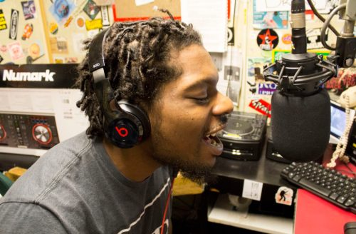 Sharrod Richard, also known as DJ Tana Glo, speaking to his listeners. Photo by Liam Olson