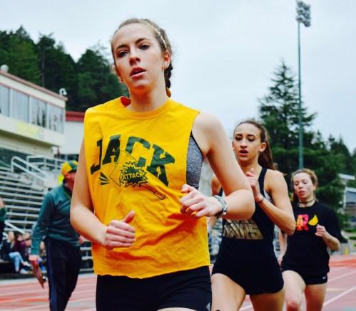 Grace Hall, HSU sprinter, running her hardest on her second lap during the women's 800 meter race on Saturday Feb. 18, 2017. | Juan Herrera