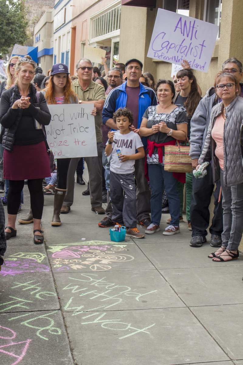 Carlo Campagna blows bubbles after chalk drawing in front of Security National building.   Photo by Ian Thompson