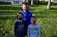 Samyoung (back), Sophia (left), and Alex Phetsouphanh (right), get ready to eat the other young souls around Eureka in the annual Zombie Walk.