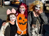 Claudia Trembly (left), Maddie Bizzard (middle), and Eva Trembly (right) are all smiles to lure in the human bait in the annual Zombie Walk on Oct. 7.