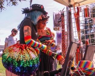 Older couple shopping at the rainbow pride booth. | Kyra Skylark