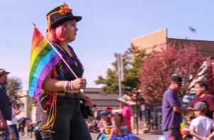 Sophia Escudero held a rainbow flag at Humboldt Pride.   Kyra Skylark
