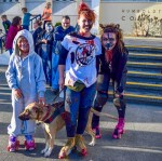 Nina Meredith (left), Hannah Meredith (middle), Rachel Stolt (right), and Goonie (dog) are all roller blading around Eureka hungry for the innocent souls in the annual Zombie Walk.