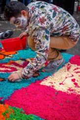 HSU freshmen Carlos Lemus helps create sawdust dye art at the Dia De Los Muertos event last Thursday at HSU.
