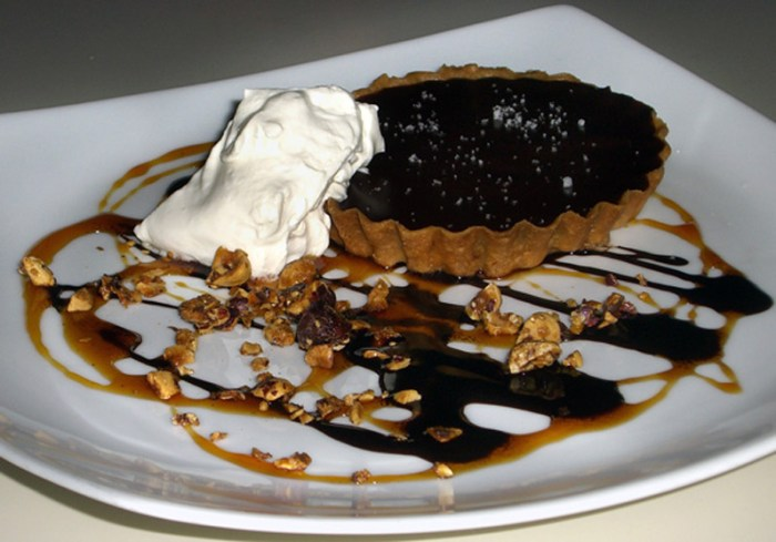 Dark Chocolate Caramel Tart with Caramel & Chocolate Sauces & Candied Hazelnuts