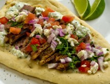 Lime-Marinated Steak Gyros with Tzatziki Sauce, Tomatoes, Onions, Feta & Mint