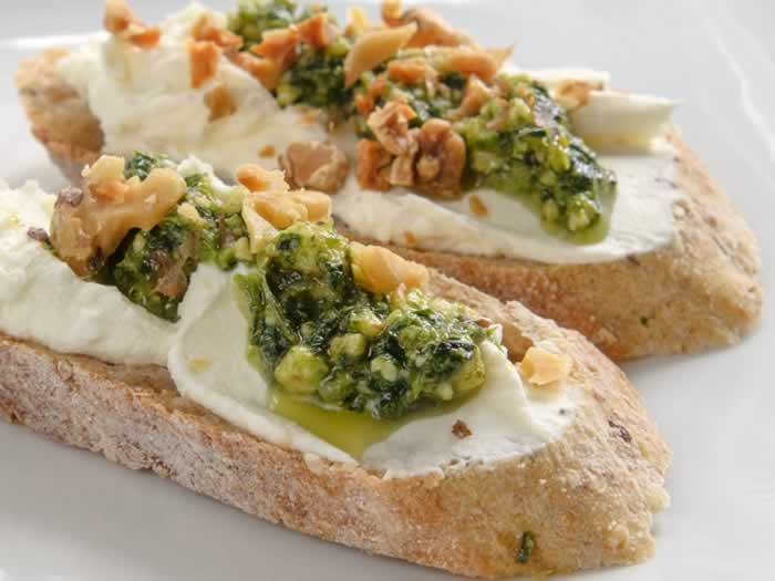 Fava Bean Greens, Walnut & Orange Pesto on Crostini