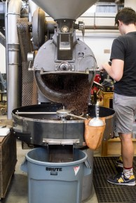 One of two roasting machines in motion, dispensing the coffee beans into a cooling tray. Photo by Griffin Dehne.